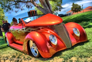 2014 Murrieta Father's Day Car Show: 1937 Ford Roadster. Beautiful burnt orange paint with flames running down the sides and ghost flames on the fenders and hood.